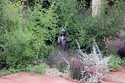 A statue in this courtyard garden