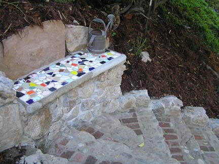 Mosaic tile and rock sitting area